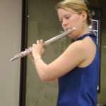 Angela playing a flute