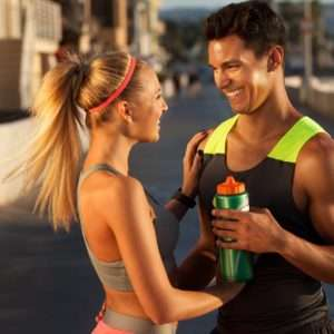 a man and a girl talking after a workout