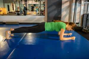 a girl doing a proper plank form