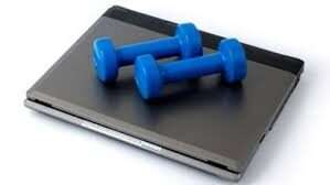 a laptop and a dumbell