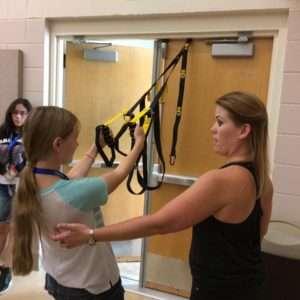 Angela assisting a girl