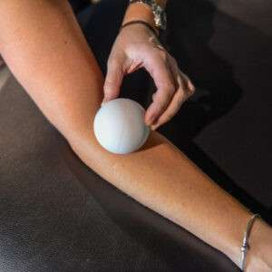 a Lacrosse Ball on top of an arm