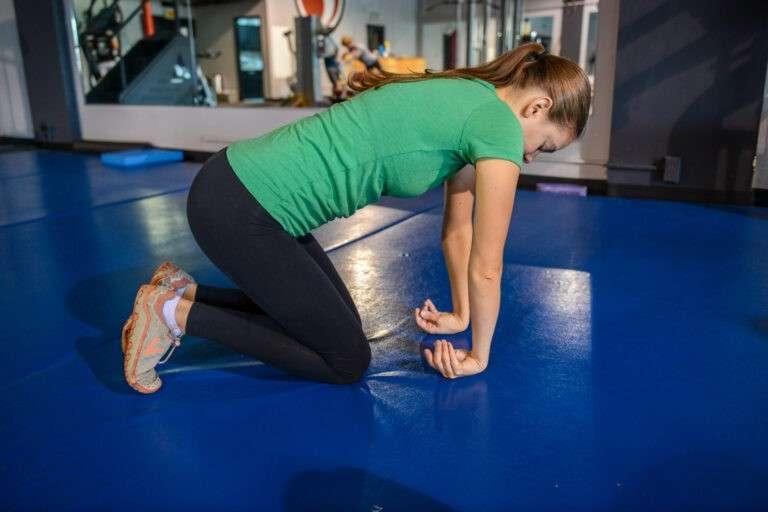 a girl doing a wrist stretch