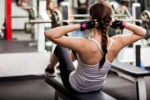 a girl exercising in the gym