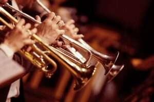 musician's playing a trombone